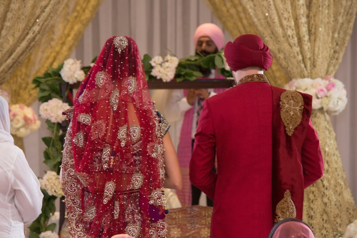 Indian bride and groom during their Anand Karaj