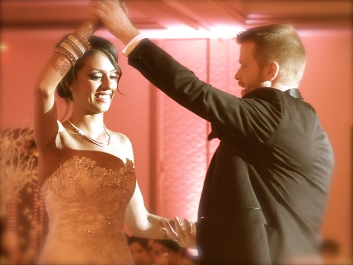 Groom twirling ride during their dance