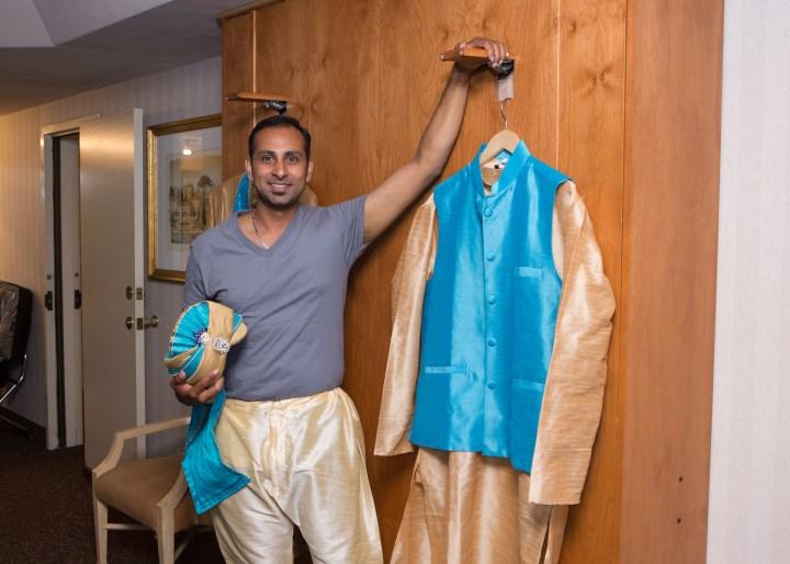 Ashmi-Suraj-Indian-wedding-venue-Hindu-Jain-ceremony-groom-sherwani-blue-turquoise