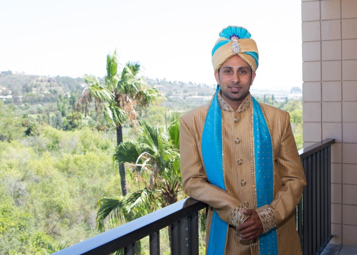 Ashmi-Suraj-Indian-wedding-venue-Hindu-Jain-ceremony-groom-sherwani-blue-turquoise-sari-updo-bride-groom