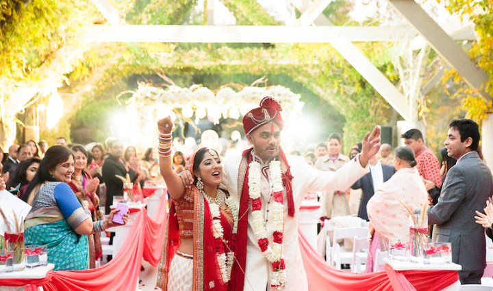 Indian-couple-walking-down-aisle-after-wedding-ceremony