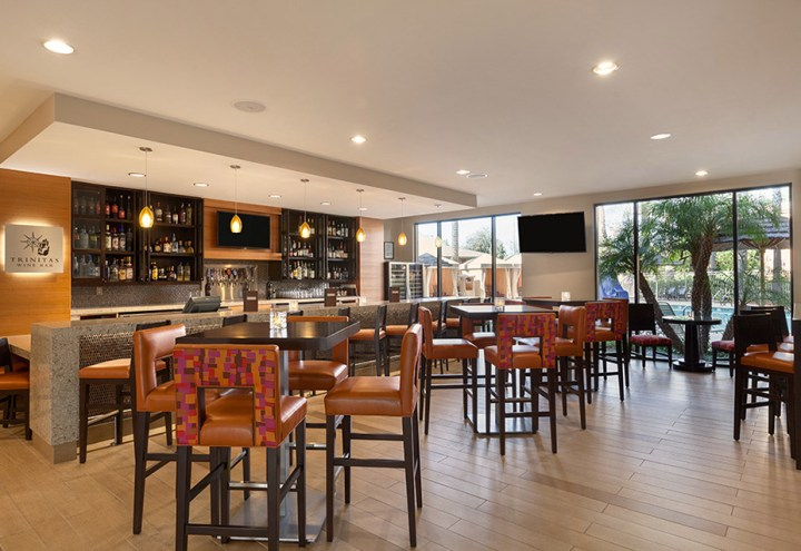 The Delta Marriott Anaheim lobby bar with comfortable high chairs.