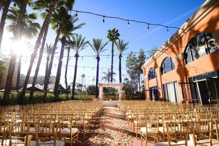 Indian wedding ceremony mandap and chairs set up on the outdoor patio at the Delta Marriott in Anaheim, California