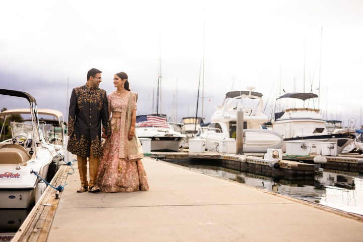 Indian couple on wedding day walking at the Marina at the Sheraton San Diego Hotel & Marina