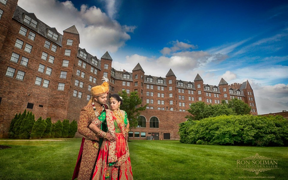 Indian ride and groom posing for a romantic photo, wearing traditional Indian wedding attire before their wedding ceremony at the Sheraton Parsippany hotel in New Jersey