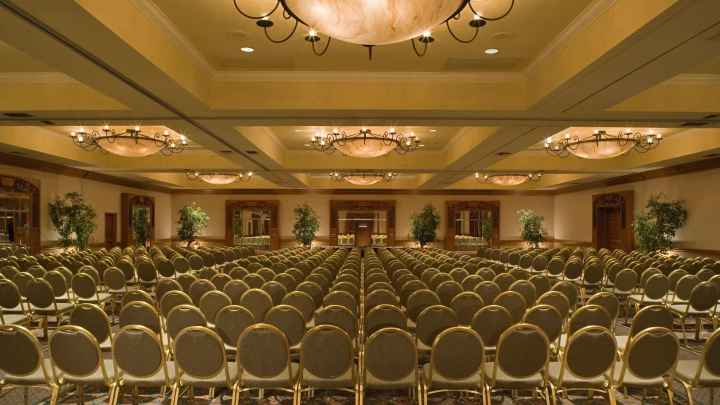 Banquet chairs setup theater style in a hotel ballroom for an event