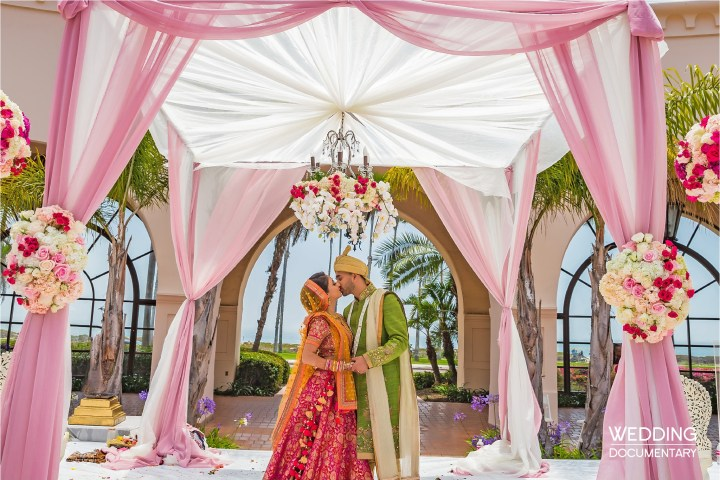 Indian couple kissing after their Hindu wedding ceremony at the Hilton Beachfront Santa Barbara
