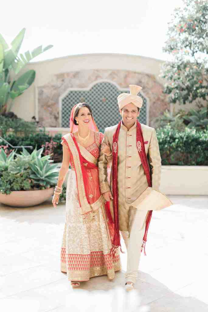 Indian bride and groom wearing traditional wedding clothes