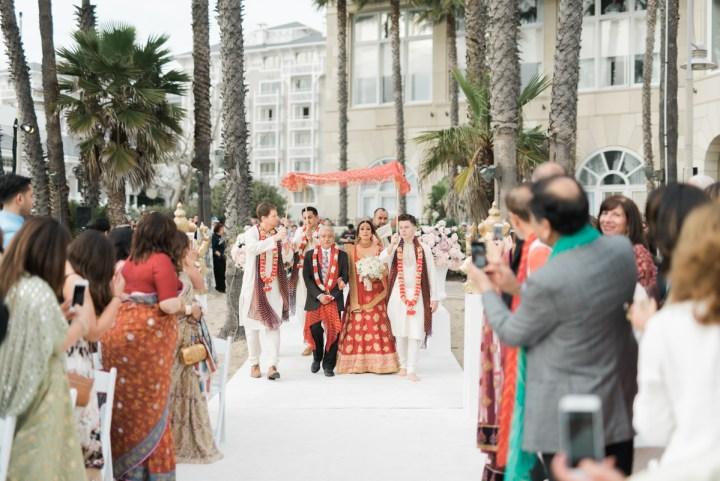 Bride walking down the aisle at an Indian wedding at Casa del Mar
