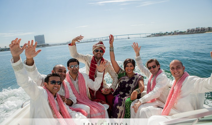 Indian groom and groomsmen on a speed boat baraat