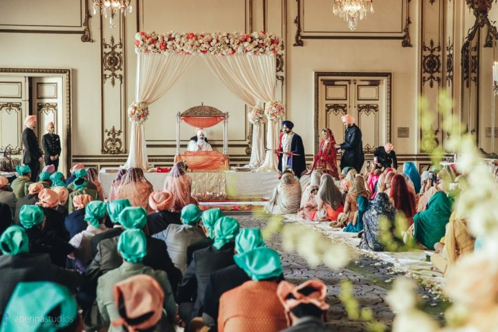 Sikh wedding ceremony and the couple taking their lavaan phere at the Fairmont San Francisco