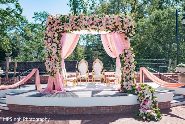 For a $50K budget Indian wedding, focus on a mandap with less flowers and more draping.