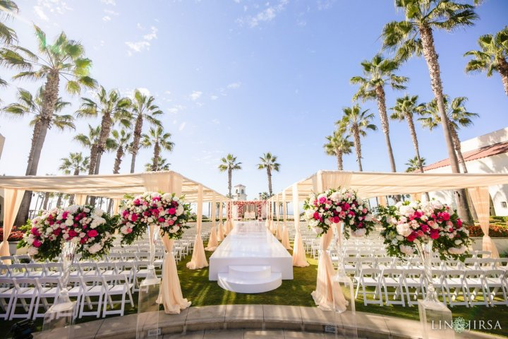 Indian wedding ceremony at the Hyatt Regency Huntington Beach with white folding chairs
