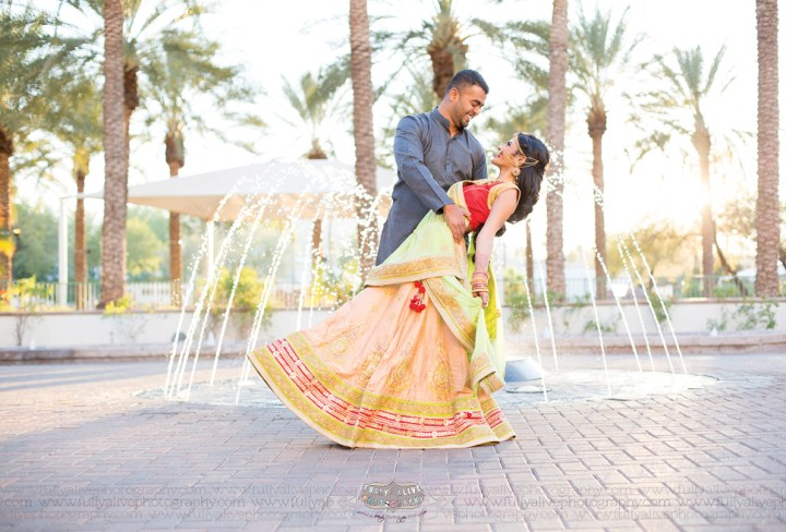 Indian couple romantic shot in front of a fountain at Arizona Grand Resort & Spa