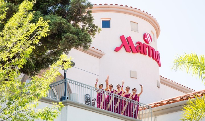 Bridesmaids waving at the baraat San Mateo Marriott