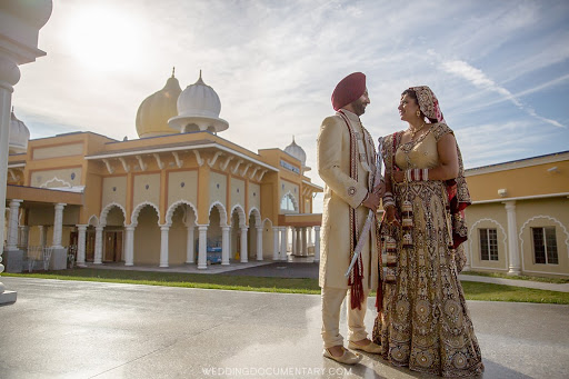 Sikh bride and groom standing outside San Jose Gurdwara