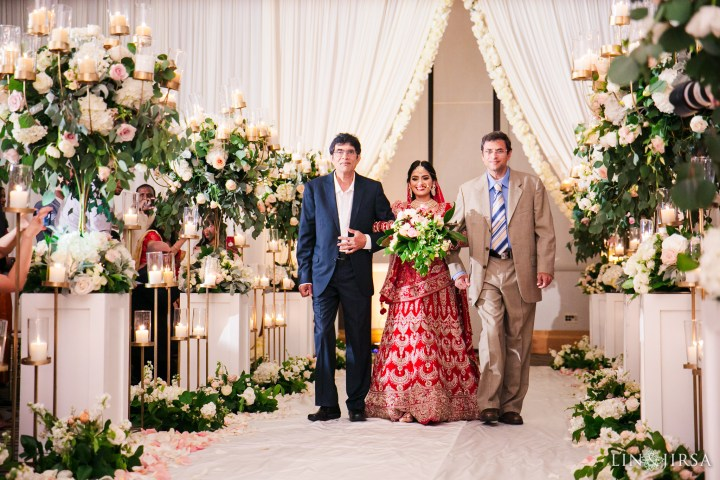 Indian bride being walked down the aisle at the San Jose Marriott