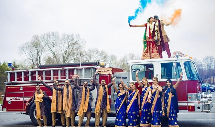 Indian wedding fire truck baraat with bride and groom and wedding party
