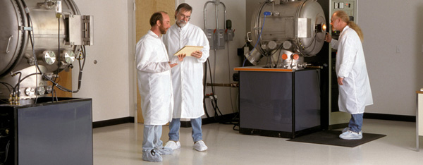 Cleanroom technicians wearing shoe covers