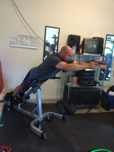 Dryfiring (with a SIRT) while working on midsection strength on a hyper extension machine. Not traditional, yet I am saving time by putting two things together in one session.
