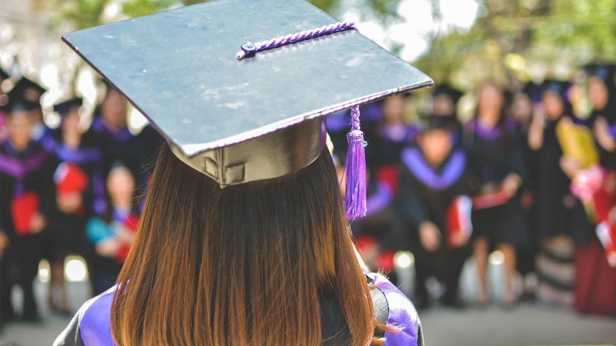graduate facing graduating class