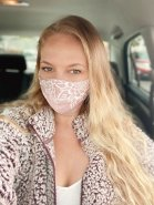 Women in her car wearing Lotus and Luna Wide Face Mask