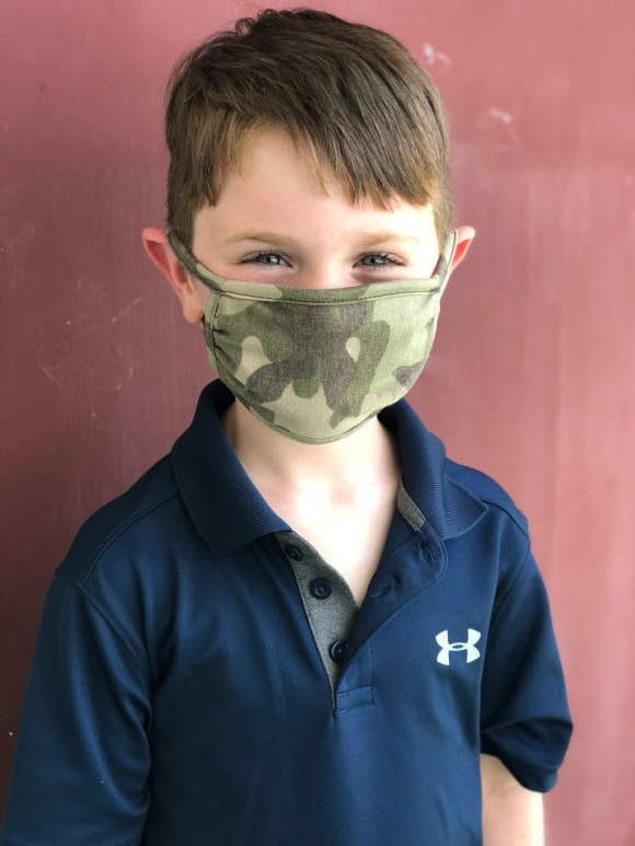 Boy in a camp face mask