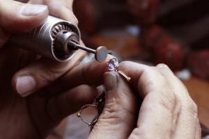 Artisan creating jewelry.