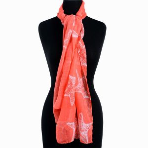 Peach scarf styled on mannequin.