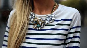 Large statement necklace worn with conservative neckline.
