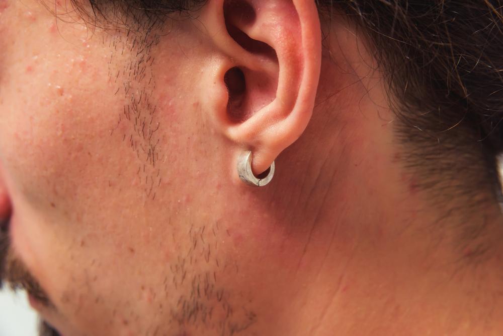 Closeup of man wearing earring