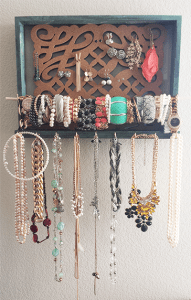 DIY picture frame jewelry holder filled with jewelry.
