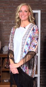 Woman wearing kimono with bright print.