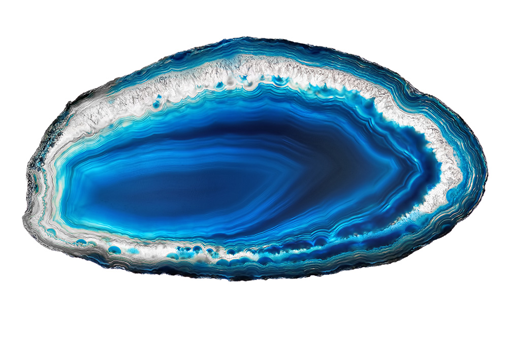 Blue agate slice against a white backdrop.