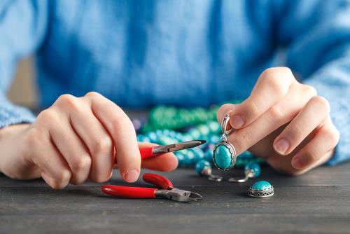 Woman making handmade jewelry.