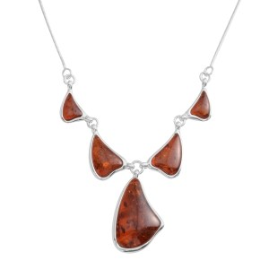Free form Baltic amber in a sterling silver necklace.