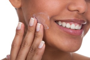 Applying moisturizer first is one of the best summer makeup tips.