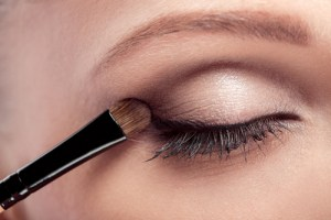 Use a powder to help eye shadow stay put.