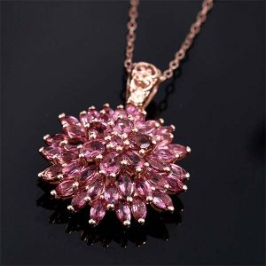 Pink spinel pendant on black background.