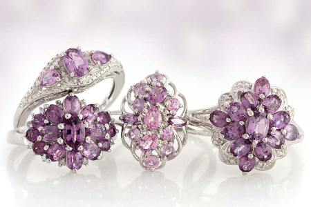 Lavender spinel rings on white background.