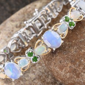 White opal and chrome diopside bracelet in sterling silver and gold.