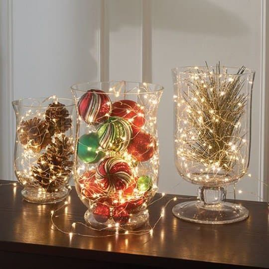Lights wrapped up on glass containers of Christmas ornaments
