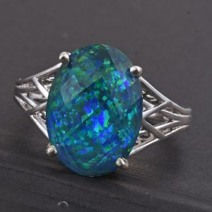 Synthetic opal doublet split shank ring in sterling silver.