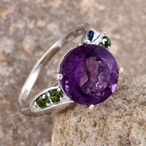 Purple fluorite statement ring in sterling silver with chrome diopside accents.