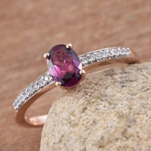 Purple garnet solitaire ring in sterling silver with 14k yellow gold finish.