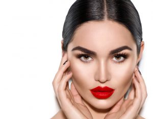 Woman with minimalistic makeup and bright red lipstick.