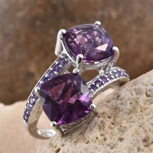 Purple fluorite bypass ring with amethyst accents in sterling silver.