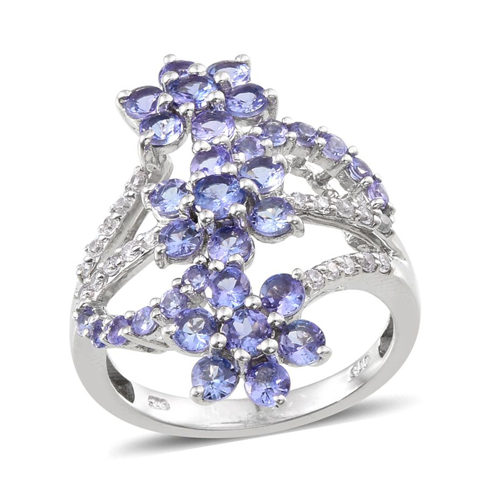 Floral ring with blue tanzanite in sterling silver.
