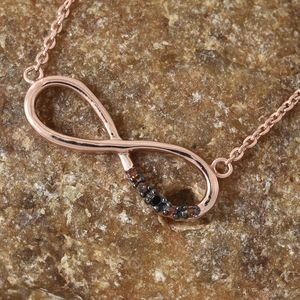 Rose gold infinity pendant with diamond accents.
