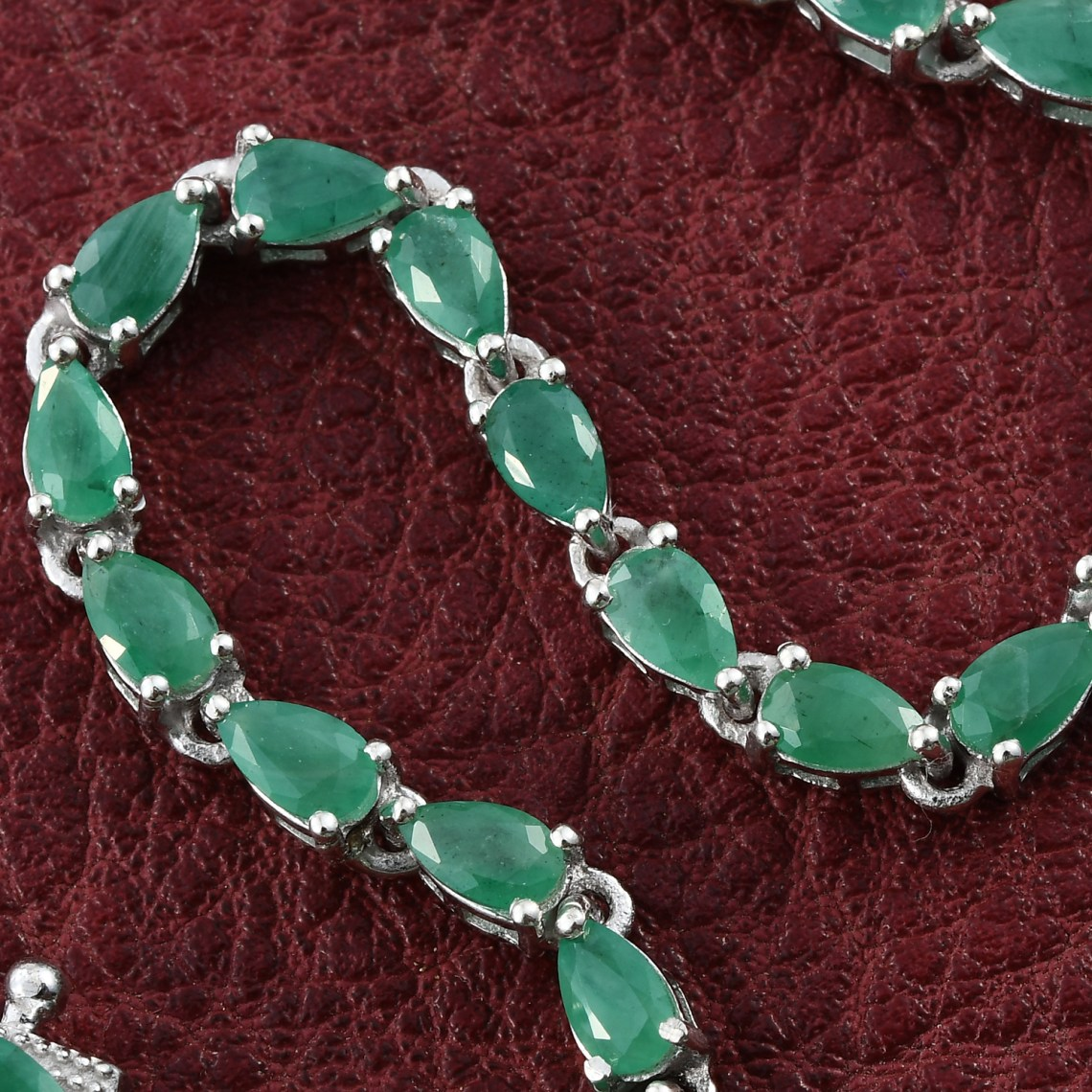 Sokoto emerald line bracelet on red background.